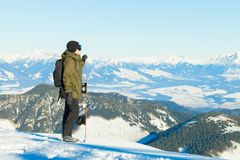 Snowboarder at the top of a mountain. Enjoying the view Royalty Free Stock Image