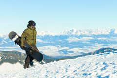 Snowboarder at the top of a mountain. Enjoying the view Royalty Free Stock Images