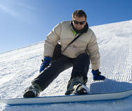 Snowboarder touchdown stock photo Royalty Free Stock Image