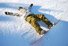 Snowboarder under sun Royalty Free Stock Images