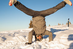 Snowboarder is upside down in the snow Royalty Free Stock Photo