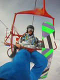 Winter sports - snowboarder using cable car royalty free stock photos