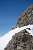 Snowboarder walking uphill for freeride Royalty Free Stock Photos