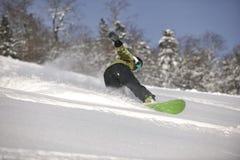Snowboarder woman enjoy freeride on fresh powder snow Stock Photo