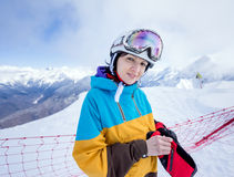 Snowboarder woman in mountains. Portrait of woman snowboarder on background beautiful landscape of snowy high mountains of Caucasus at Krasnaya Polyana Stock Photography