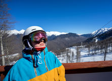 Snowboarder woman in mountains. Portrait of woman snowboarder with closed eyes on background beautiful landscape of snowy high mountains of Caucasus at Krasnaya Royalty Free Stock Photo