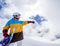 Snowboarder woman in mountains Stock Image
