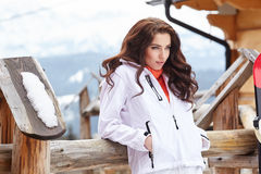 Snowboarder woman outdoors. Winter resort Stock Photo