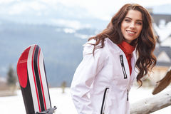Snowboarder woman outdoors. Winter resort Royalty Free Stock Photos