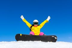 Snowboarder woman sitting on snow mountain slope Stock Images
