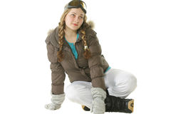 Snowboarder woman sitting on white Royalty Free Stock Image