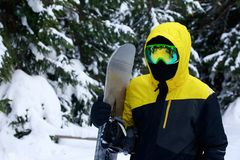 Snowboarder in a yellow jacket stock photography