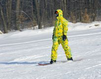 Snowboarder in a yellow suit Stock Image