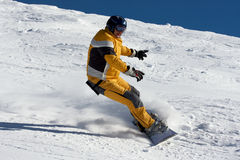 Snowboarder in yellow suite Royalty Free Stock Image