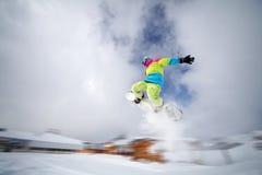 Snowboarderheckzupacken stockfotografie