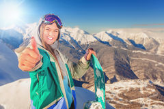 Snowboardermeisje bij Alpen, Zwitserse berg De activiteiten van de winter Royalty-vrije Stock Foto's