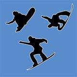 3 snowboardersöversikter på en vit bakgrund Arkivbild