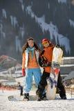 Snowboarders afortunados de los pares Imágenes de archivo libres de regalías