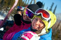 Snowboarders on the chairlift Stock Photo