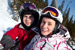 Snowboarders on the chairlift Stock Photography