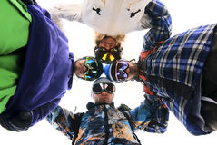 Snowboarders in circle looking down stock images