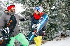 Snowboarders couple in mountain on skiing stock images