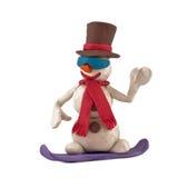 Snowboarders da equitação do boneco de neve da massa de modelar Fotos de Stock Royalty Free