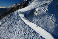 Snowboarders descending the ski track in Rosa Khutor, Russia Royalty Free Stock Photography