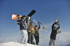 Snowboarders group relaxing and enjoy sun Royalty Free Stock Photo