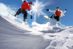 Free Snowboarders Jumping Against Clear Sky Stock Photo - 11196660