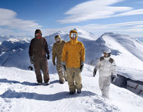 Snowboarders in the mountains Stock Photo
