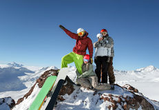 Snowboarders in the mountains Stock Photography