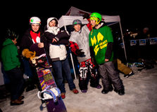 Snowboarders at night. Royalty Free Stock Photo