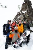 Snowboarders på berget royaltyfria foton