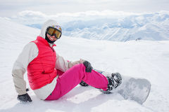 Snowboarders is posing at camera Royalty Free Stock Photo