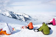 Snowboarders preparing to ride a slope Stock Photo