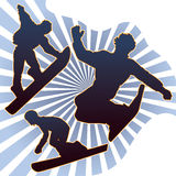 Snowboarders silhouettes Stock Images