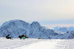 Snowboarders sit on snow on the slopes of Mountain Elbrus Caucasus royalty free stock image