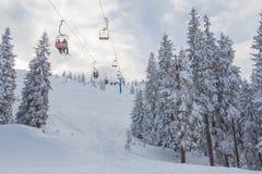 Snowboarders on a ski lift Stock Photo