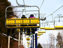 Snowboarders & Skier Family on Chairlift Royalty Free Stock Images