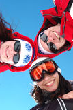 Snowboarders and skiers stock images