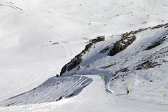 Snowboarders and skiers on groomed slope Stock Images