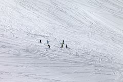 Snowboarders and skiers on off piste slope Royalty Free Stock Photo