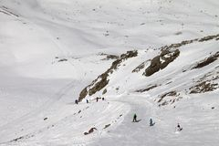 Snowboarders and skiers on ski slope at sun day Stock Image