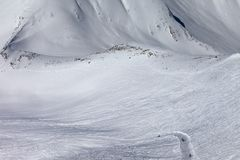 Snowboarders and skiers on slope and off-piste slope with trace Royalty Free Stock Photography