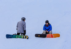 Snowboarders on the slopes Royalty Free Stock Photos