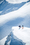Snowboarders on of snowy mountains Royalty Free Stock Image