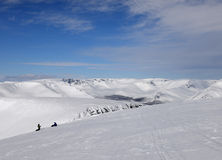 Snowboarders on the top of the winter mountains Royalty Free Stock Images
