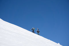 Snowboarders walking uphill for freeride. Extreme sport Royalty Free Stock Image