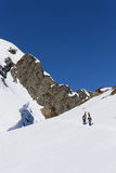 Snowboarders walking uphill for freeride. Extreme sport Stock Photo
